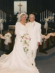 Newly married senior Christians stand side by side at the altar