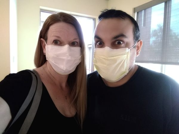 Christian couple being silly while wearing COVID masks