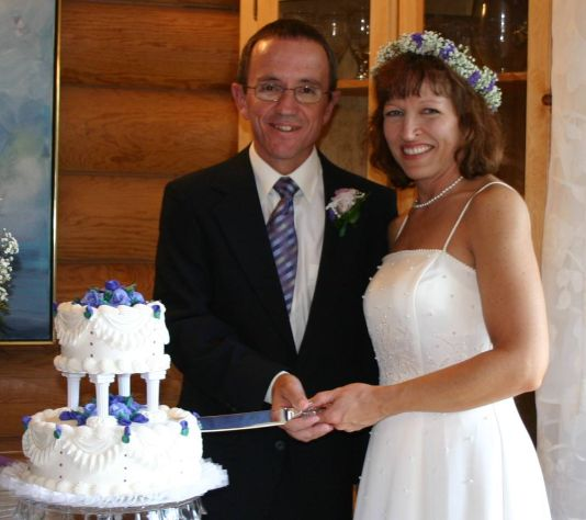 Very happy formerly single Christian from Arkansas cuts wedding cake with California Christian match