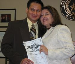 A married couple hold up their marriage license