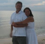 Northwestern Christian couple hug on beach
