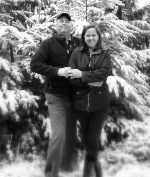 Former Christian singles holding hands and standing in front of forest in winter as they celebrate 11 years