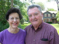 A beautiful country home behind two senior Christians in love
