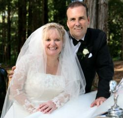 Australian Christians laugh together on their wedding day