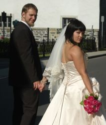 Bride and groom Looking back as they walk away