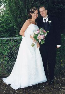 California Christian man stands next to his beautiful Canadian Christian bride