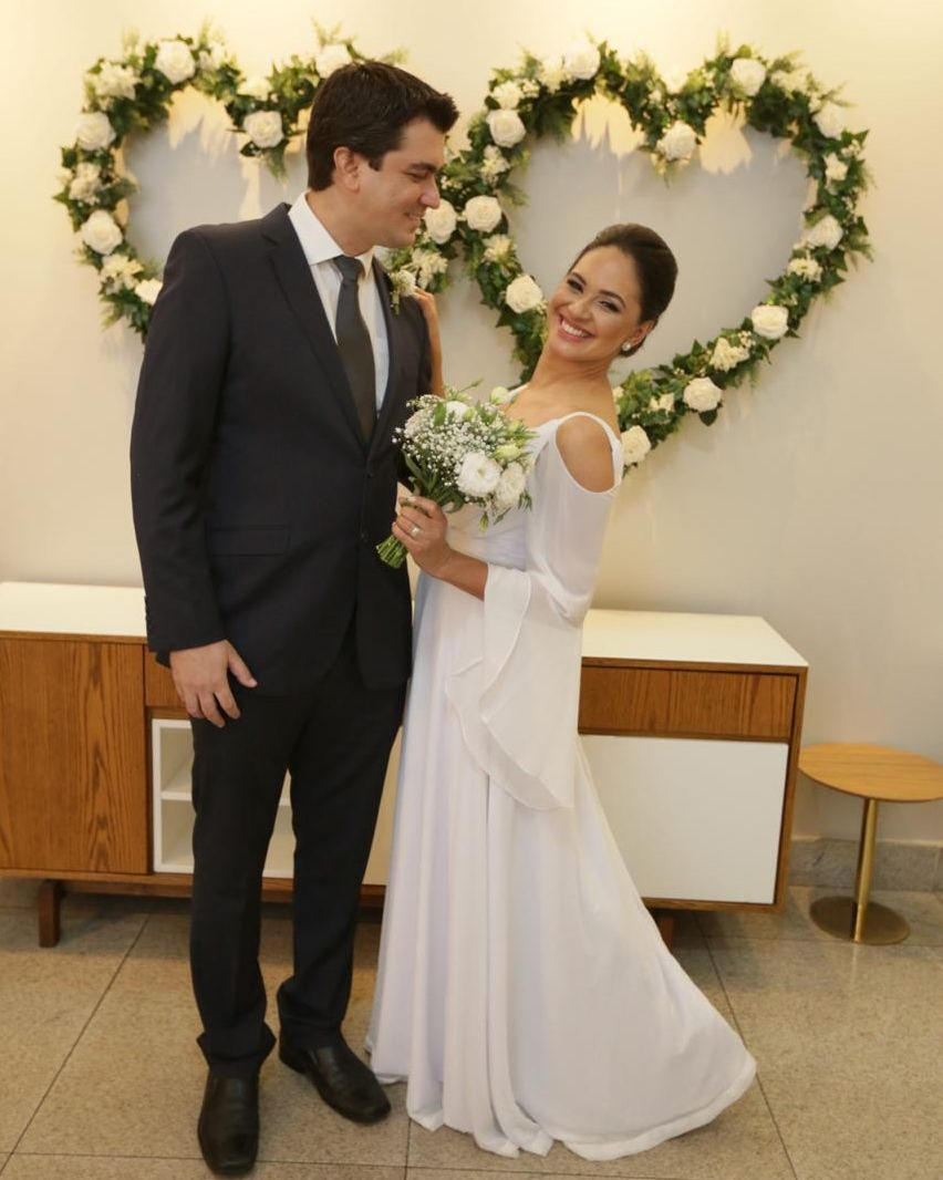 Christian groom smiling at his Brazilian Christian wife while she beams at camera