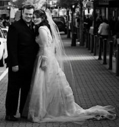 New Zealand wedding for this couple who smile while leaning in close on their wedding day