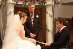 TN Christian single in a wedding dress sits next to an Alabama Christian single at their wedding