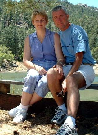 Divorced Christians find love. Couple sitting on bench on nature hike