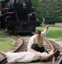 Man rescues bride from train tracks