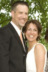 Beautiful Christian couple from New York stand next to each other and smile ear to ear
