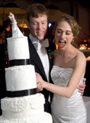 The wedding cake nearly topples over with Nicole's excitement