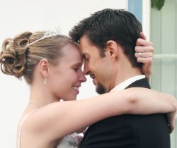 Marital bliss for Christian couple who hug closely and prepare to kiss