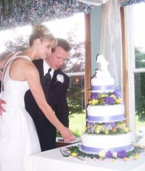 Happily married Christians from PA cut a beautiful wedding cake