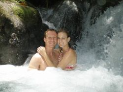 Honeymoon under a waterfall for Christian couple