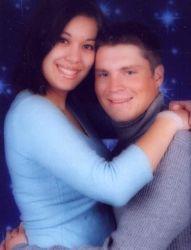 Joyful Christian couple hug on their 1st anniversary and look very comfortable together