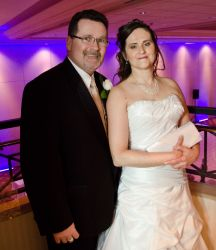 Ontario newlyweds stand side by side on the dance floor