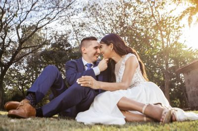 Smiling Christian couple on grass in tender moment