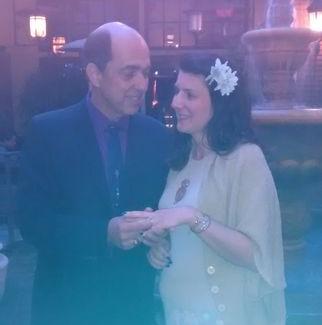 Smiling California Christian puts wedding ring on his new California bride