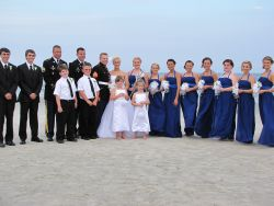 Huge wedding party shown on the beach