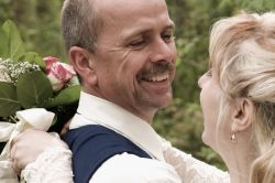 Christian couple laugh comfortably and hug after marrying