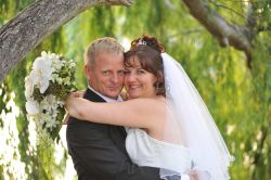 Former Australian Christian singles hug and smile broadly after marrying
