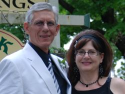 Love for Christian singles in Missouri on their wedding day in front of a cross