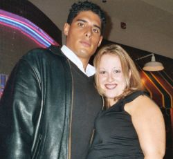 Christian single patiently seeks out great guy. Smiling woman standing next to a tall handsome man