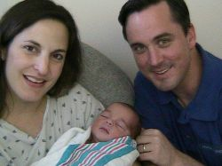 Bible believing Christians look very proud as they hold their newborn baby