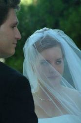 A pretty Christian bride in a veil is shown with her husband as they get married
