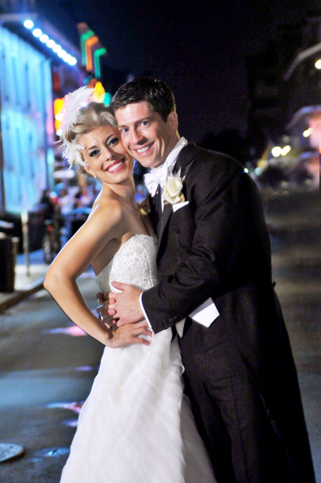 Stunning Christian couple hug in a street after marrying