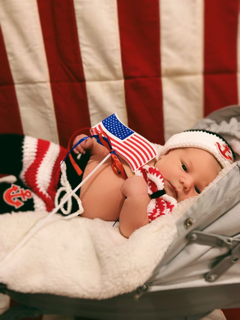 Newest Patriot holds American flag