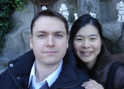 Christian single man from Ontario looks very pleased to meet a beautiful Asian Christian woman, who leans over his shoulder and smiles
