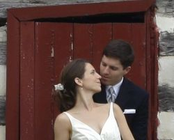 Virginia Christian single has best day of her life after marrying. A woman leans back against a door to kiss a man in a nice suit