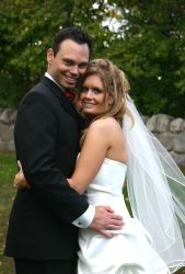 Melina holds on tight to her new husband