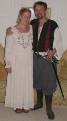 Christian singles in Renaissance clothes smile together