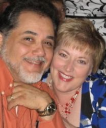 Texas Chaplain finds love online and is shown leaning close to a smiling pretty woman
