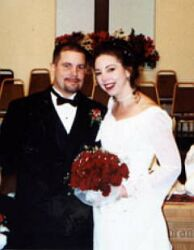 Attractive Christian couple smile at altar after marrying