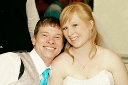 A young Christian couple laughing and leaning in together just after marrying