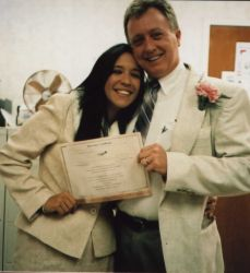 Bible believing Christians hold up their marriage license and laugh together