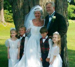 Senior Christians marry and stand next to grandchildren