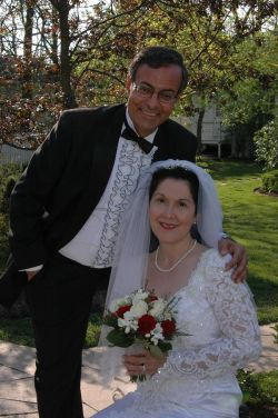 Former single from Ontario leans over and puts his arm around his beautiful bride