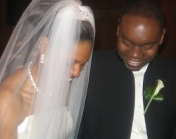 Newly married Christians laugh together in a touching moment
