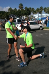 Christian single man from California proposes on bent knee before a marathon