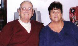 Oklahoma Christian seniors sit close together and smile