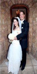 Beautiful wedding setting as newly married couple hug