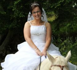 Fairy tale wedding for Irish Christian woman who is seated on a horse