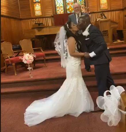 COVID wedding kiss