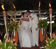 Kiss at the altar surrounded by flames